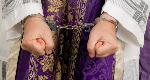 Handcuffs-on-priest-via-Shutterstock-800x430